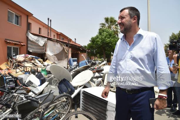 Italys Interior Minister and deputy PM Matteo Salvini stands by a pile of garbage as he tours the centre on July 9, 2019 during the closure of...