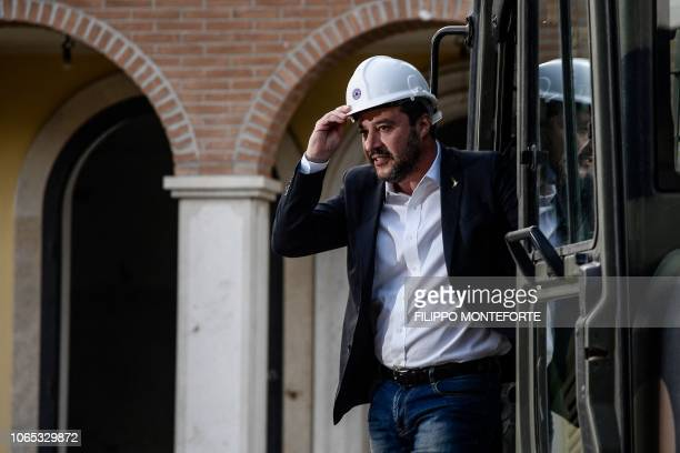 Italys Interior Minister and deputy PM Matteo Salvini stands on a bulldozer as he prepares to preside over the demolition of some of eight illegally...
