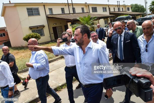 Italys Interior Minister and deputy PM Matteo Salvini tours the centre on July 9 2019 during the closure of Europe's onetime biggest asylum seeker...