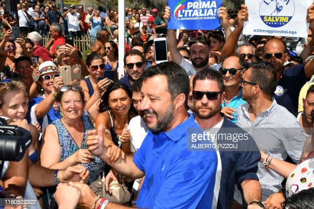 Italy's Interior minister and deputy Prime Minister Matteo Salvini smiles as he's surrounded by supporters during his electoral tour Italian Summer...