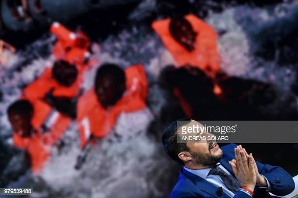 TOPSHOT Italy's Interior Minister and Deputy Prime Minister Matteo Salvini speaks during the Italian talk show Porta a Porta broadcast on Italian...