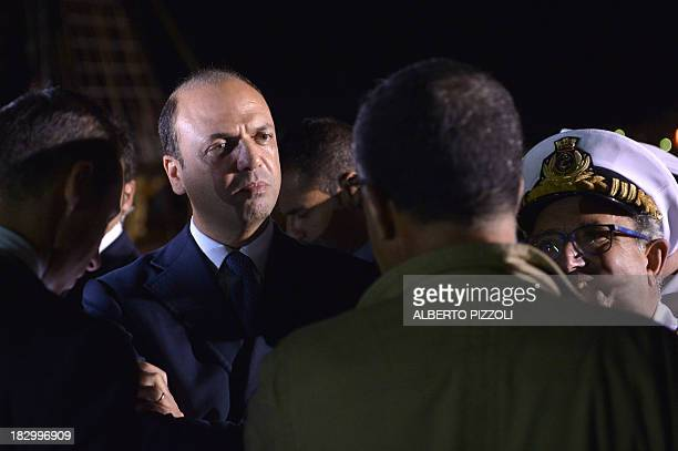 Italy's Interior Minister Angelino Alfano arrives in Lampedusa on October 3 2013 after a boat with up to 500 African asylum seekers caught fire and...