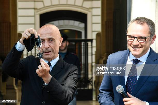Italy's Interior Minister Marco Minniti flanked by Stefano Domenicali Chief Executive Officer of Automobil Lamborghini shows the key of the new...
