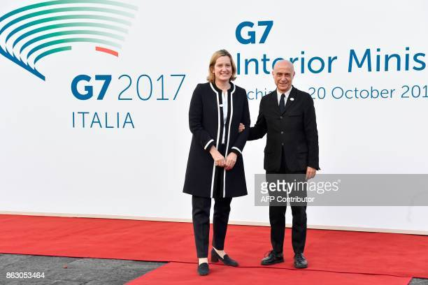 Italy's Interior Minister Marco Minniti welcomes British Secretary of State for the Home Department Amber Rudd on October 19 2017 near the Aragonese...