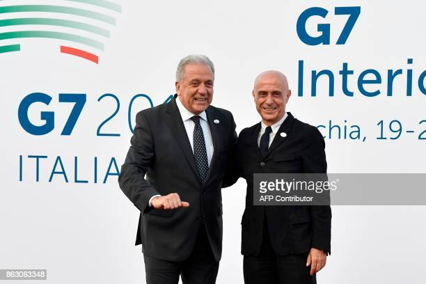 Italy's Interior Minister Marco Minniti welcomes EU Commissioner for Migration Home Affairs and Citizenship Dimitris Avramopoulos on October 19 2017...