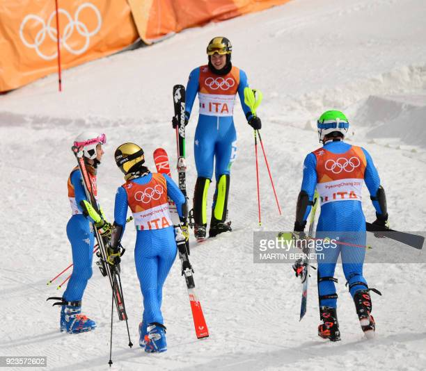 Italy's Irene Curtoni Alex Vinatzer Chiara Costazza and Riccardo Tonetti react after competing in the Alpine Skiing Team Event quarterfinals at the...