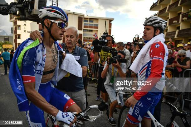 Italy's Jacopo Guarnieri and France's Arnaud Demare are pictured after they crossed the finish line of the twelfth stage of the 105th edition of the...