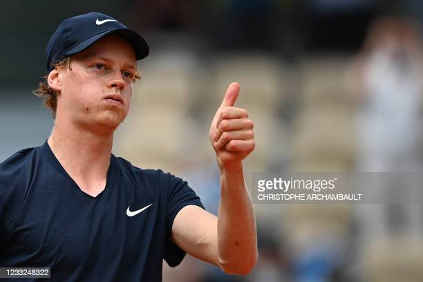 Italy's Jannik Sinner celebrates after winning against Italy's Gianluca Mager during their men's singles second round tennis match on Day 5 of The...