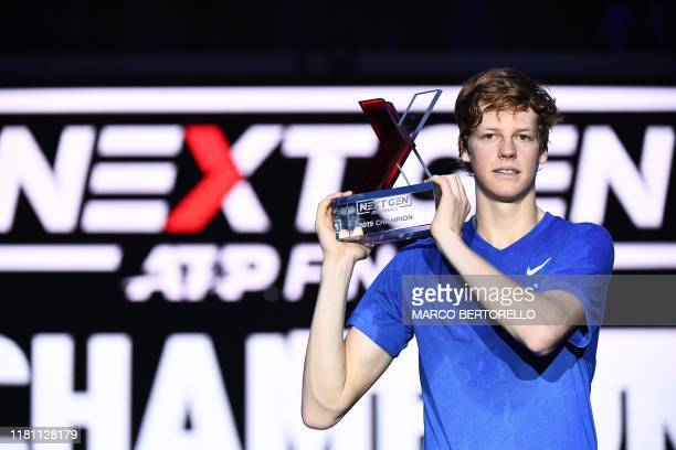 Italy's Jannik Sinner poses with the winner's trophy after defeating Australia's Alex De Minaur during the final of the Next Generation ATP Finals at...