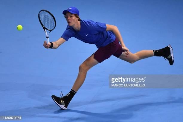 Italy's Jannik Sinner returns the ball to Serbia's Miomir Kecmanovic during their semifinal match of the Next Generation ATP Finals at the Allianz...