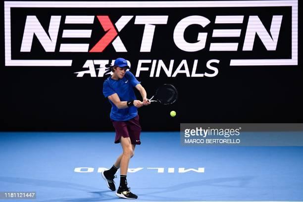 Italy's Jannik Sinner returns to Australia's Alex De Minaur during the final of the Next Generation ATP Finals at the Allianz Cloud Court on November...
