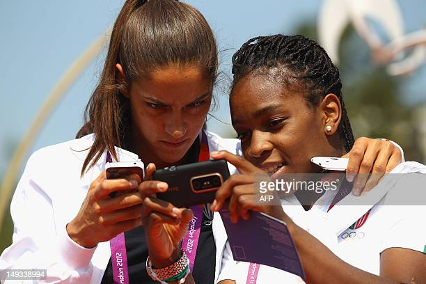 Italy's judokas Giulia Quintavalle and Edwige Gwend arrive at the Olympic Village ahead of the London 2012 Olympic Games at the Olympic Park on July...