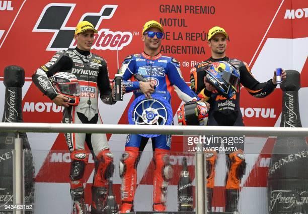 Italy's Kalex biker Mattia Pasini Spain's Kalex biker Xavi Vierge and Portugal's KTM biker Miguel Oliveira celebrate their first second and third...