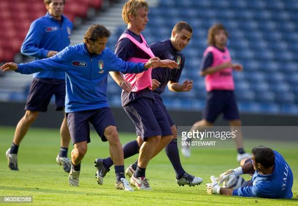 Italy's Kepper Peruzzi saves at the feet of Danielle de Rossi with Alessandro del Piero and Fabio Cannavaro covering as Italy trains for the Scottish...