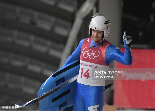 Italy's Kevin Fischnaller gestures after competing in the men's luge singles run 4 final during the Pyeongchang 2018 Winter Olympic Games at the...