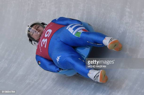 Italy's Kevin Fischnaller takes a corner during a training session for the men's luge singles during the Pyeongchang 2018 Winter Olympic Games at the...