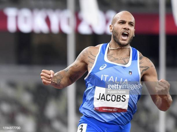 Italy's Lamont Marcell Jacobs reacts after winning the men's 100-meter final of the Tokyo Olympics on Aug. 1 at the National Stadium.