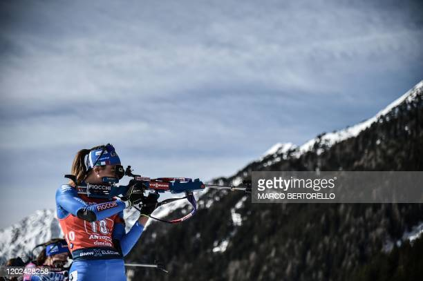 Italy's Lisa Vittozzi competes at the shooting range during the Women 4x6 km Relay Competition at the IBU Biathlon World Cup in Rasen-Antholz ,...