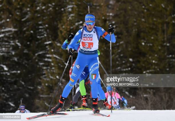 Italy's Lisa Vittozzi competes in the IBU Biathlon World Cup 4x6 Mixed Relay in Rasen-Antholz , Italian Alps, on February 13, 2020.