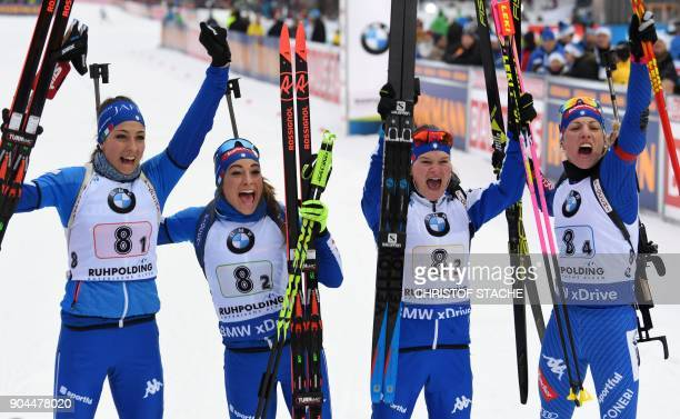 Italy's Lisa Vittozzi Dorothea Wierer Nicole Gontier and Federica Sanfilippo celebrate placing second in the women's 4 x 6 km relay event of the...
