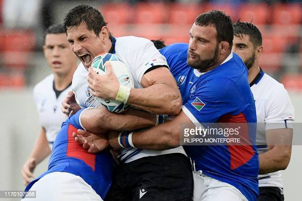 Italy's lock Alessandro Zanni reacts as he is tackled during the Japan 2019 Rugby World Cup Pool B match between Italy and Namibia at the Hanazono...