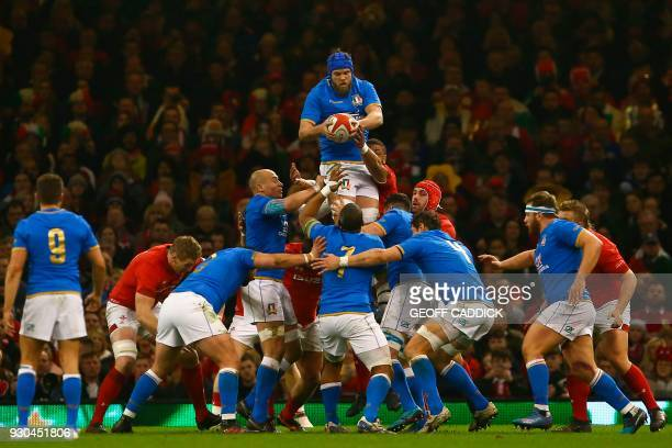 TOPSHOT Italy's lock Dean Budd catches the ball from a lineout during the Six Nations international rugby union match between Wales and Italy at the...