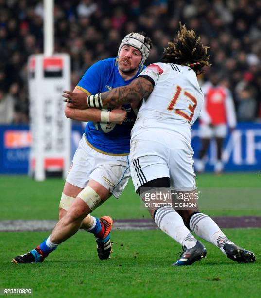 Italy's lock George Biagi is is tackled by France's centre Mathieu Bastareaud during the Six Nations international rugby union match between France...