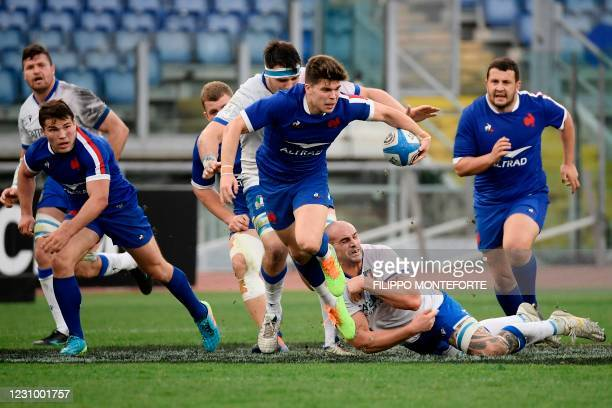 Italy's lock Marco Lazzaroni attempts to tackle France's fly-half Matthieu Jalibert during the Six Nations rugby union tournament match between Italy...
