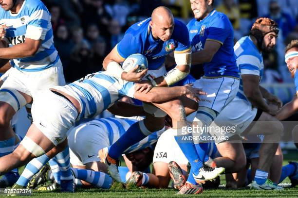 Italy's lock Sergio Parisse tries to escape from a tackle during the International Rugby Union Test match between Italy and Argentina at the Artemio...