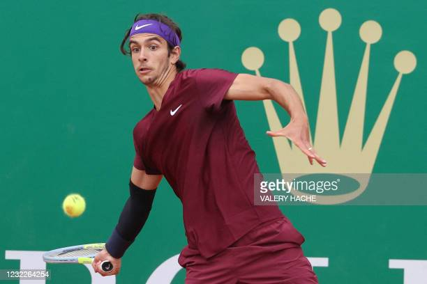 Italy's Lorenzo Musetti returns the ball to Russia's Aslan Karatsev during their first round singles match on day two of the Monte-Carlo ATP 1000...