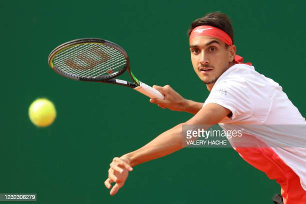 Italy's Lorenzo Sonego plays a return during his second round singles match against Germany's Alexander Zverev on day five of the Monte-Carlo ATP...