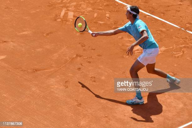 Italy's Lorenzo Sonego returns the ball to Great Britain's Cameron Norrie during their tennis match on the day 6 of the MonteCarlo ATP Masters Series...