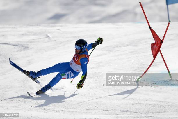Italy's Luca de Aliprandini falls while competing in the Men's Giant Slalom at the Jeongseon Alpine Center during the Pyeongchang 2018 Winter Olympic...