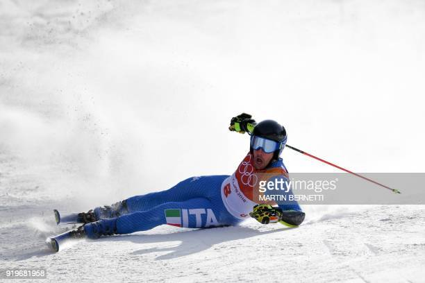 Italy's Luca de Aliprandini reacts after falling while competing in the Men's Giant Slalom at the Jeongseon Alpine Center during the Pyeongchang 2018...