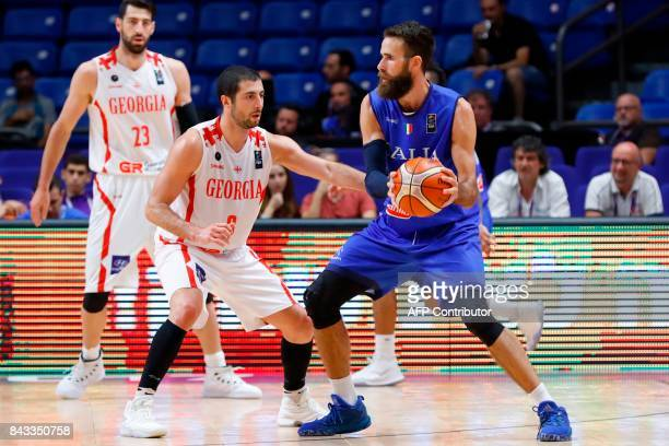 Italy's Luigi Datome vies with Georgia's Anatoli Boisa during the FIBA EuroBasket 2017 championship match between Georgia and Italy at Menora...
