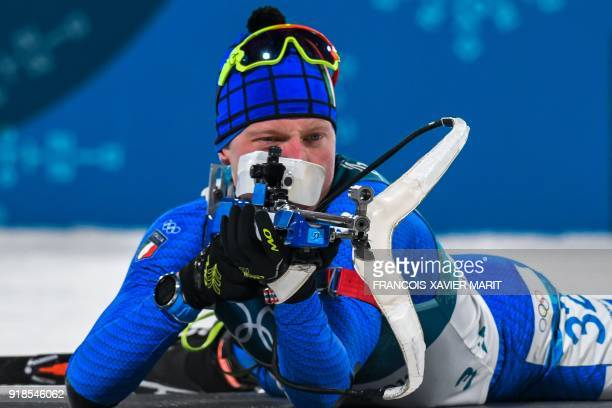Italy's Lukas Hofer competes at the shooting range in the men's 20km individual biathlon event during the Pyeongchang 2018 Winter Olympic Games on...
