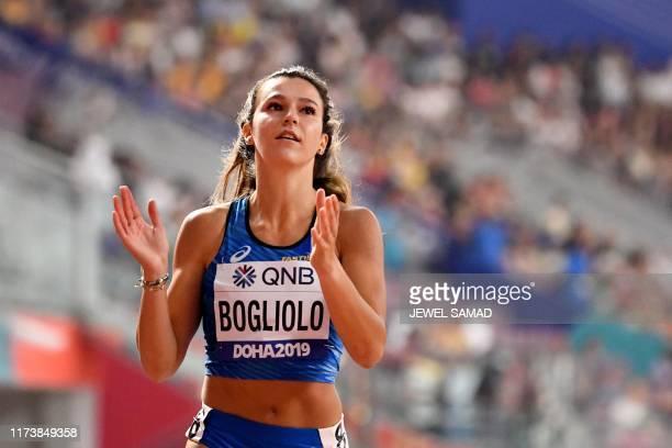Italy's Luminosa Bogliolo competes in the Women's 100m Hurdles heats at the 2019 IAAF Athletics World Championships at the Khalifa International...