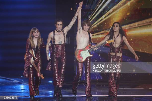 Italy's Maneskin celebrate on stage after winning the final of the 65th edition of the Eurovision Song Contest 2021, at the Ahoy convention centre in...