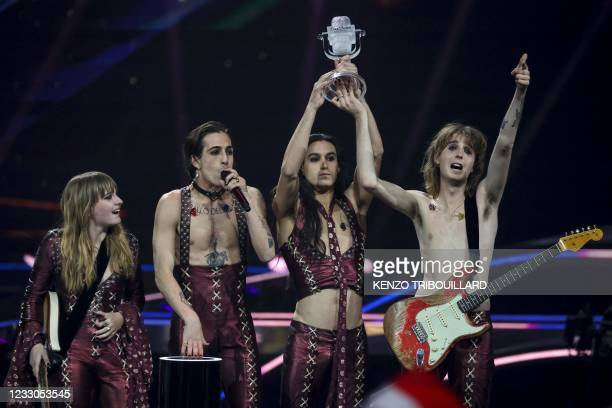 Italy's Maneskin celebrate on stage with the trophy after winning the final of the 65th edition of the Eurovision Song Contest 2021, at the Ahoy...