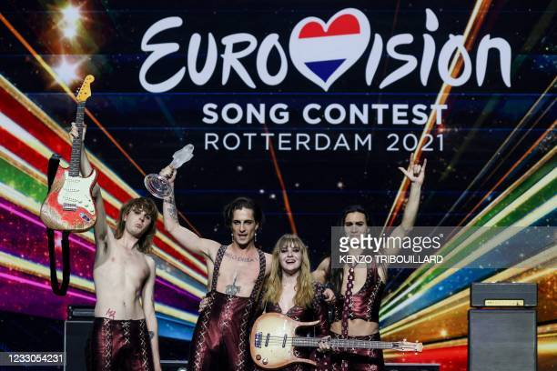 Italy's Maneskin pose for pictures on stage with the trophy after winning the final of the 65th edition of the Eurovision Song Contest 2021, at the...