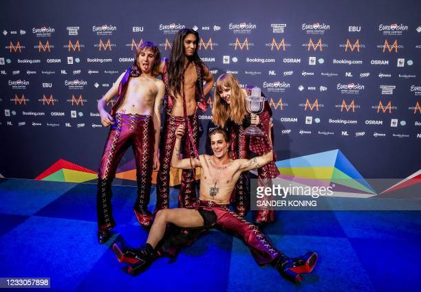 Italy's Maneskin poses with their trophy at the end of a press conference after winning the final of the 65th Eurovision Song Contest at the Ahoy...