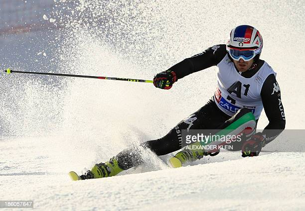 Italy's Manfred Moelgg competes during the first run of the men's giant slalom at the FIS Ski World Cup on October 27 2013 in Soelden AFP PHOTO /...