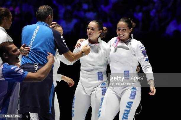 Italy's Mara Navarria and Frederica Isola celebrate during the women's Epee Team event for the third place at the 2019 Fencing World Championships in...