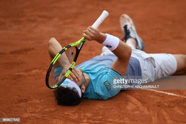 Italy's Marco Cecchinato celebrates after victory in his men's singles fourth round match against Belgium's David Goffin on day eight of the Roland...