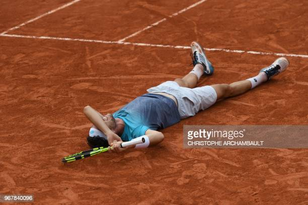 Italy's Marco Cecchinato celebrates after victory over Serbia's Novak Djokovic during their men's singles quarter-final match on day ten of The...