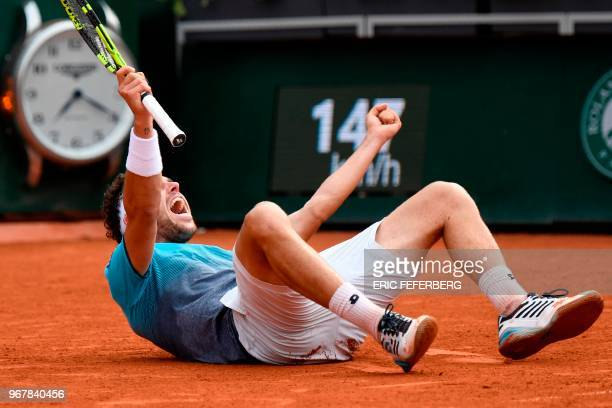 TOPSHOT Italy's Marco Cecchinato celebrates after victory over Serbia's Novak Djokovic during their men's singles quarterfinal match on day ten of...
