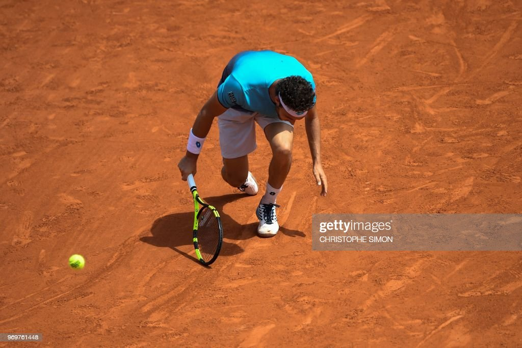 Italy's Marco Cecchinato plays a backhand return to Austria's Dominic Thiem during their men's singles semi-final match on day thirteen of The Roland Garros 2018 French Open tennis tournament in Paris on June 8, 2018.