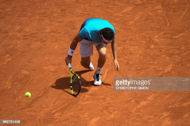 Italy's Marco Cecchinato plays a backhand return to Austria's Dominic Thiem during their men's singles semifinal match on day thirteen of The Roland...