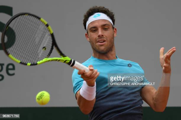 Italy's Marco Cecchinato plays a forehand return to Argentina's Marco Trungelliti during their men's singles second round match on day four of The...