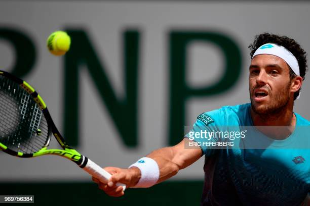 Italy's Marco Cecchinato plays a forehand return to Austria's Dominic Thiem during their men's singles semifinal match on day thirteen of The Roland...
